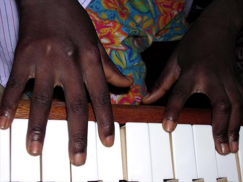 Fingers on piano