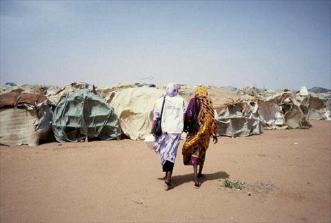 Two women in a refugee camp